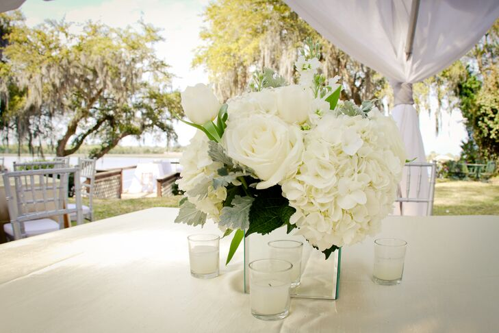 Elegant Ivory Floral Centerpieces With Mirror Vases