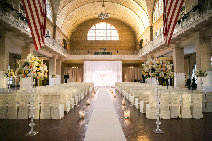 "The day kicked off with a ceremony in the iconic Registry Room at Ellis Island in New York City. The high ceilings and stately arches set a grand, elegant tone for the evening, with soft candlelight and lush arrangements of hydrangeas and garden roses displayed atop tall, silvery stands only adding to the effect. ""We walked down the aisle, which was lined with candles, just as the sun was setting and the pink and purple sky painted the windows like stained glass,"" Lauren says. ""The setting looked so magical, it was almost haunting."""