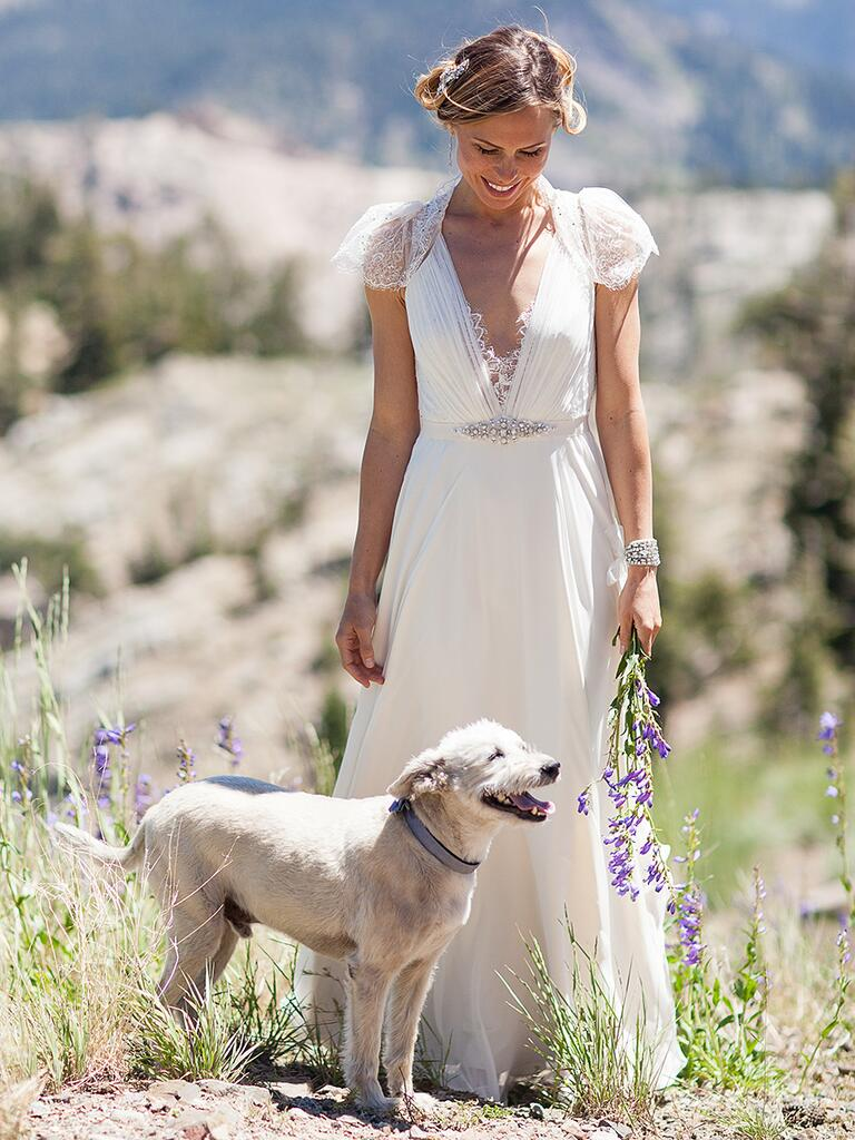 A-line Jenny Packham wedding dress with lace cap sleeves and plunging neckline