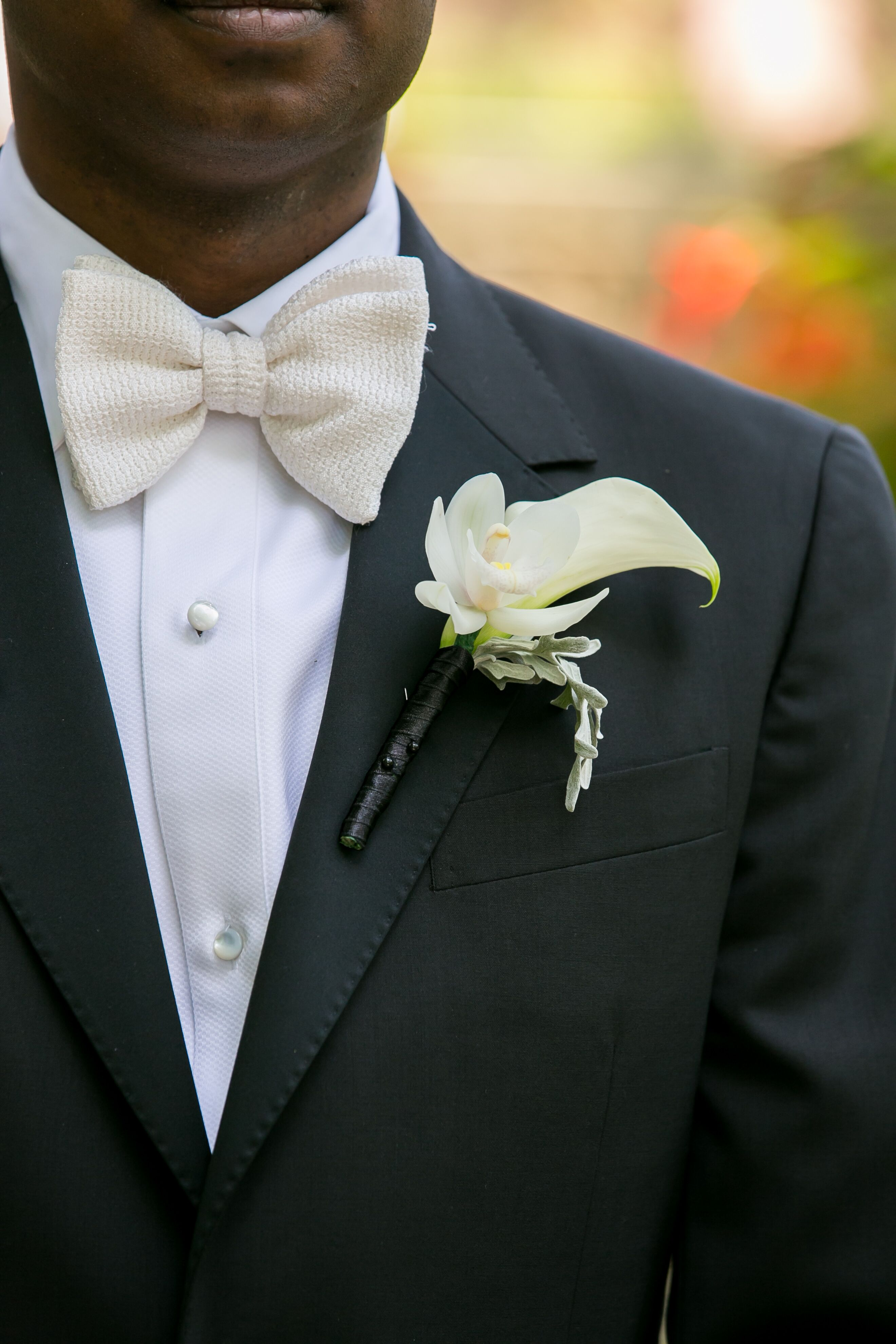 Ivory Orchid And Calla Lily Boutonniere