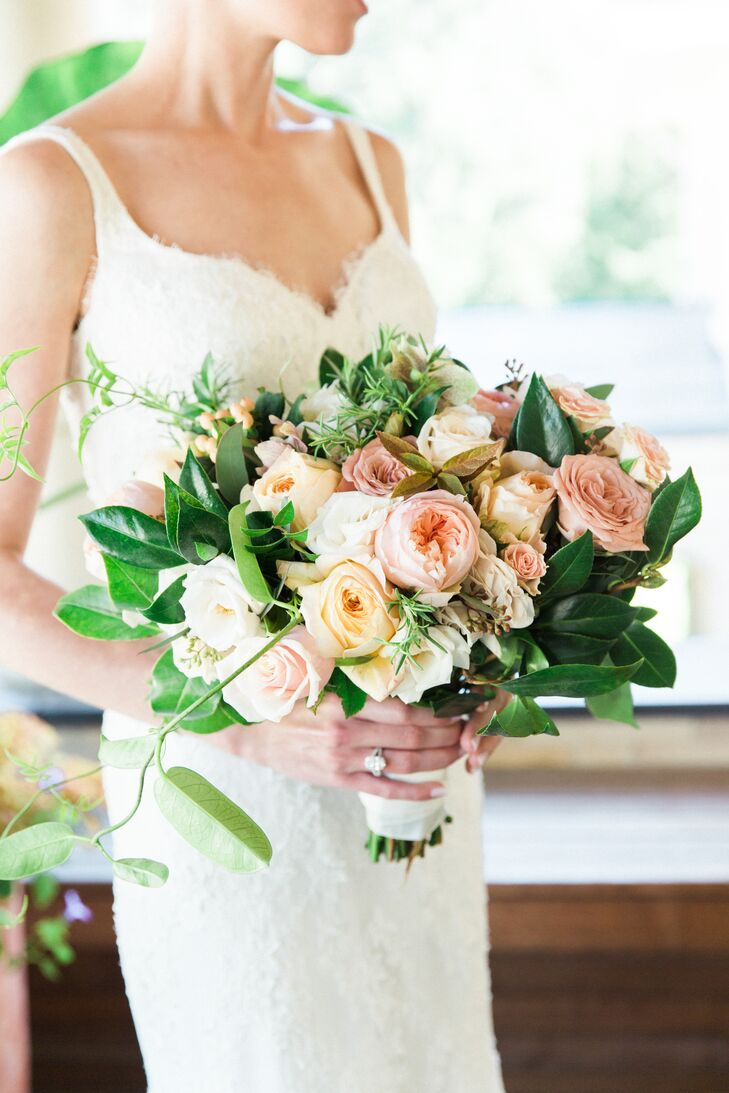 Sayles Livingston pulled together a striking bundle of romantic blooms for Katie's walk down the aisle. Overflowing with garden roses, ranunculus, hydrangeas, lisianthus and hypericum in shades in peach, ivory and blush, adding an element of softness to Katie's Monique Lhuillier trumpet-style gown.