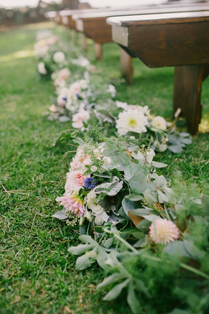 At the ceremony, the aisle was lined with a fragrant medley of sage, lavender and rose petals, while the aisle itself was lined on both sides with lush pink and green garlands.