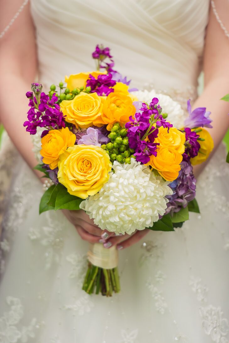 centerpiece wedding flowers bouquet of yellow purple and white flowers 2531