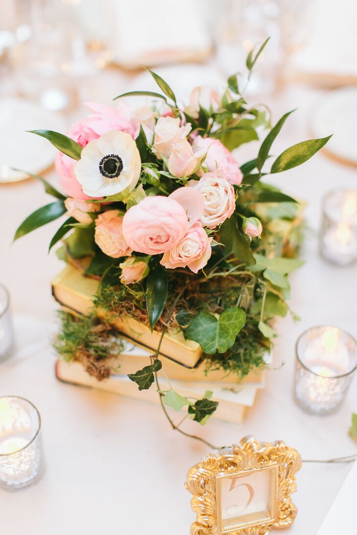 Vintage book and pink ranunculus centerpieces