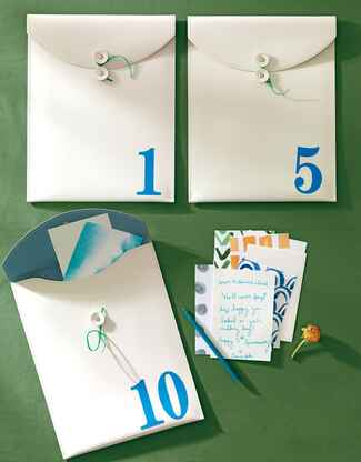 White envelopes for anniversary guest book notes
