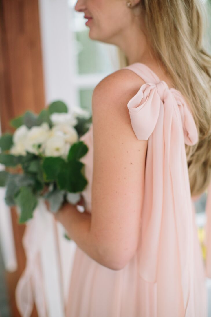 """I knew I wanted the Jenny Yoo bridesmaid dress early on,"" Elke says. ""I love that they can be converted and the pink was the perfect shade for all of my bridesmaids! My bridesmaids are so beautiful and each one played up the dress a different way."""