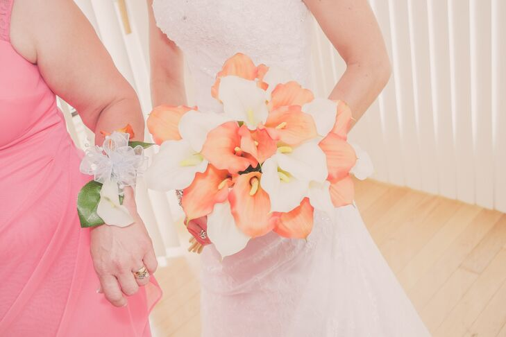 Stephanie carried a bouquet of imitation orange and white calla lilies made by her mother.