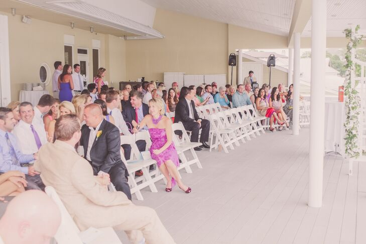The ceremony was held outdoors on the Lesner Inn dock with views of the ocean.