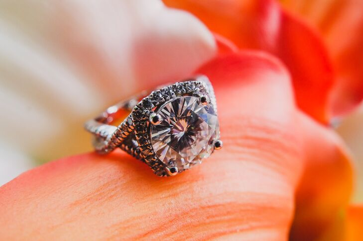 Nate proposed to Stephanie at the beach with a cushion cut diamond ring with a twist setting.
