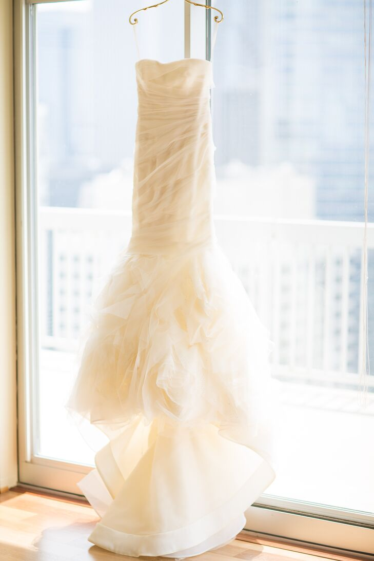 "For her walk down the aisle, Emily donned an ivory Vera Wang design that incorporated French tulle and silk organza. ""We wanted our attire to feel timeless and classic in order to match the formality of our black-tie-optional wedding,"" she says."