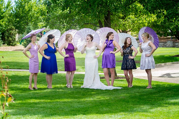 """I had four bridesmaids and gave them only a few guidelines on dresses: a cocktail length dress in any shade of purple with nude shoes"" says Ashley. ""I liked the idea of different shades of purple and different dress styles and they all have great style, so I trusted their judgment!"""