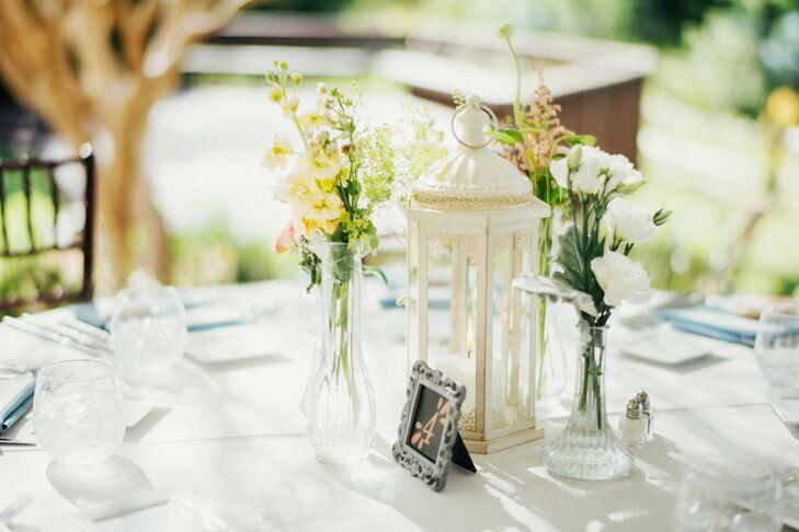 Cream Lantern And Glass Bud Vase Centerpieces
