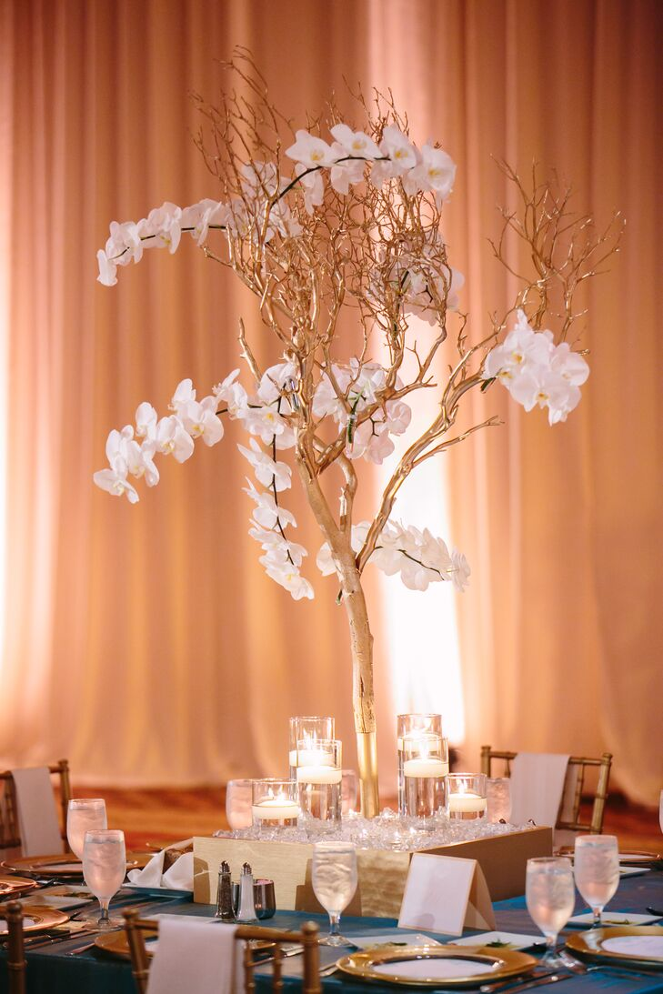 Gold branches and orchid centerpiece