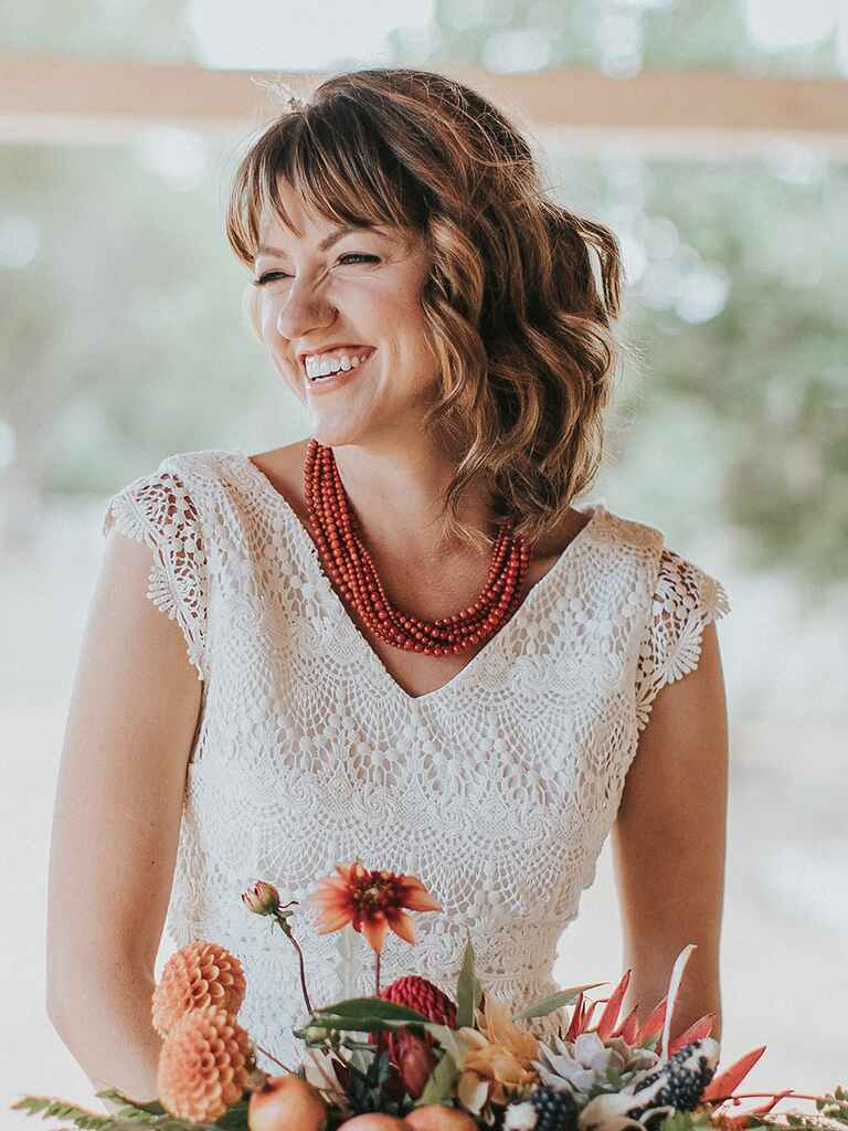 Layered lob with bangs wedding day hairstyle