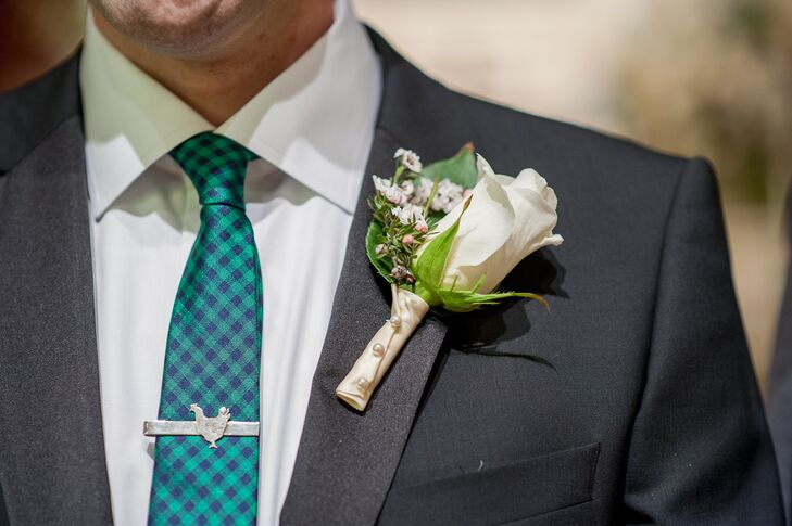 Ben had a single ivory rose boutonniere pinned onto his black tuxedo jacket.