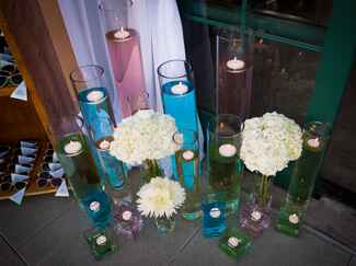 Floating candles and ivory flower arrangements