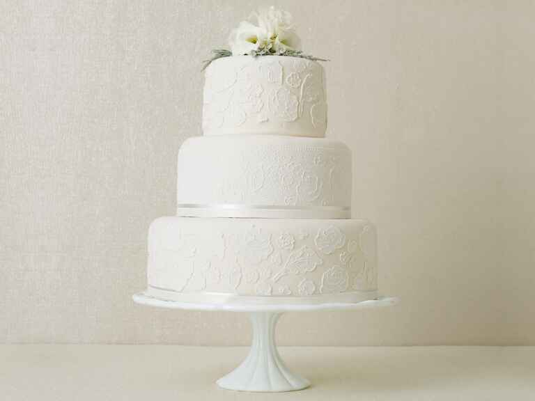 White 3-tier winter wedding cake with flower topper