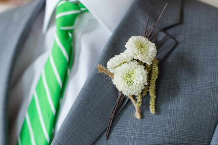 Three mini white dahlias were used for the groomsmen's boutonnieres.