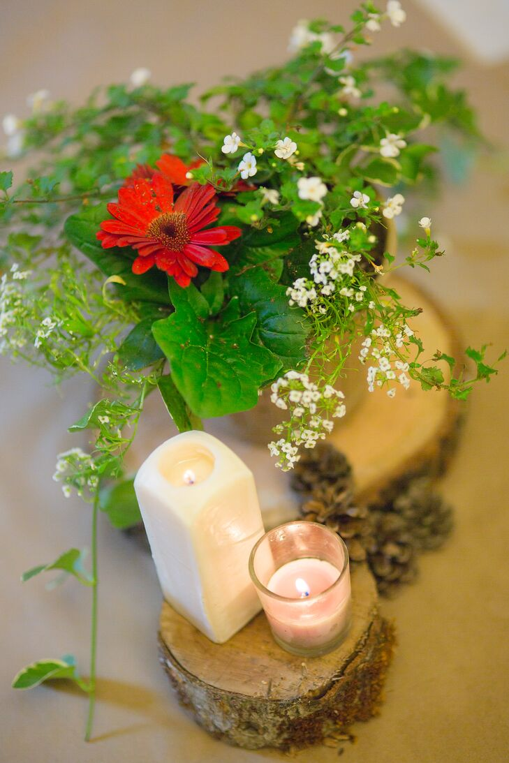 Rustic red gerbera daisy and candle centerpieces