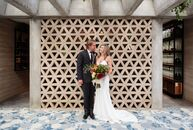Tropical foliage and macramé accents lent Tara Jobin and Dylan Ramsey's mid-century modern wedding a laid-back, bohemian edge. Tucked in the foothills