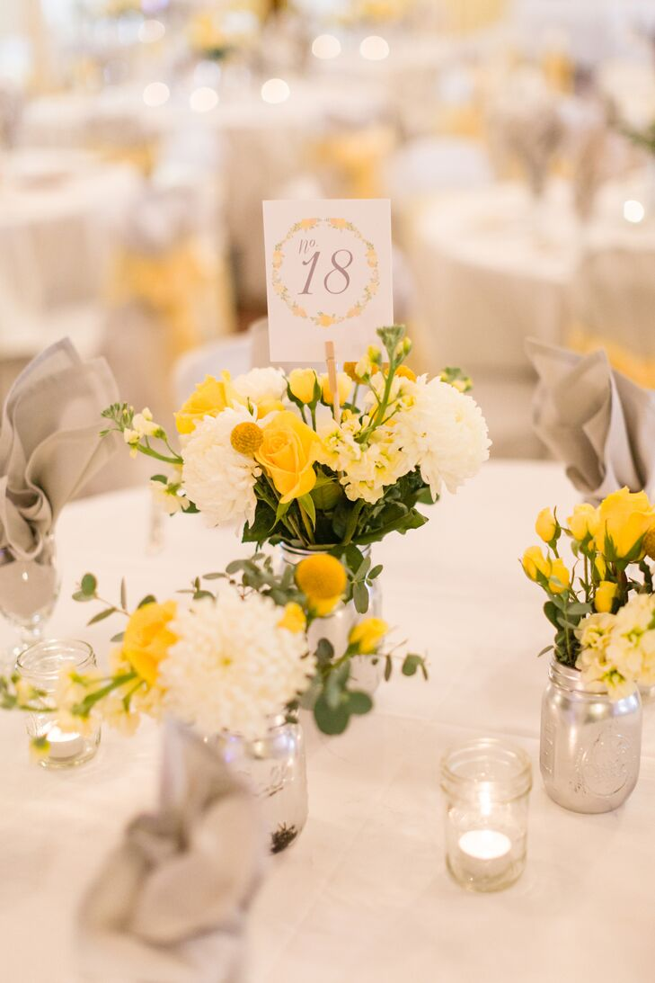 Yellow and white centerpiece with mums craspedia