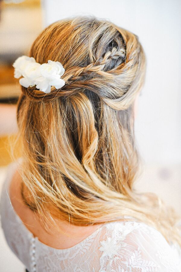 Braided Half-Updo with Floral Accessory