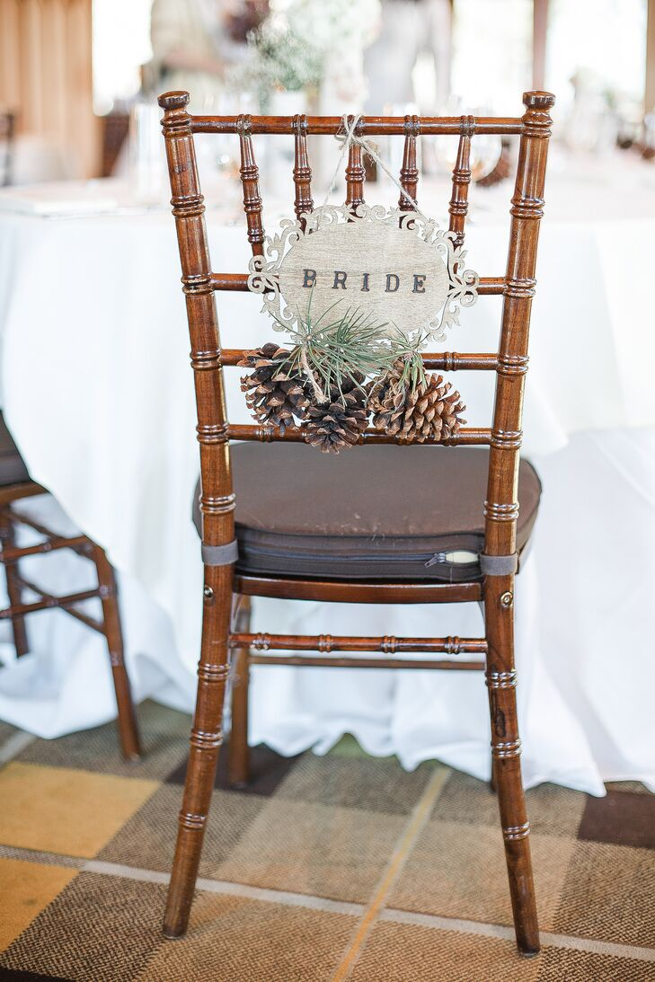 Justin made and stained the wooden chair signs on his and Lissette's chiavari chairs. He added pinecones and greenery for a totally Lake Tahoe touch.