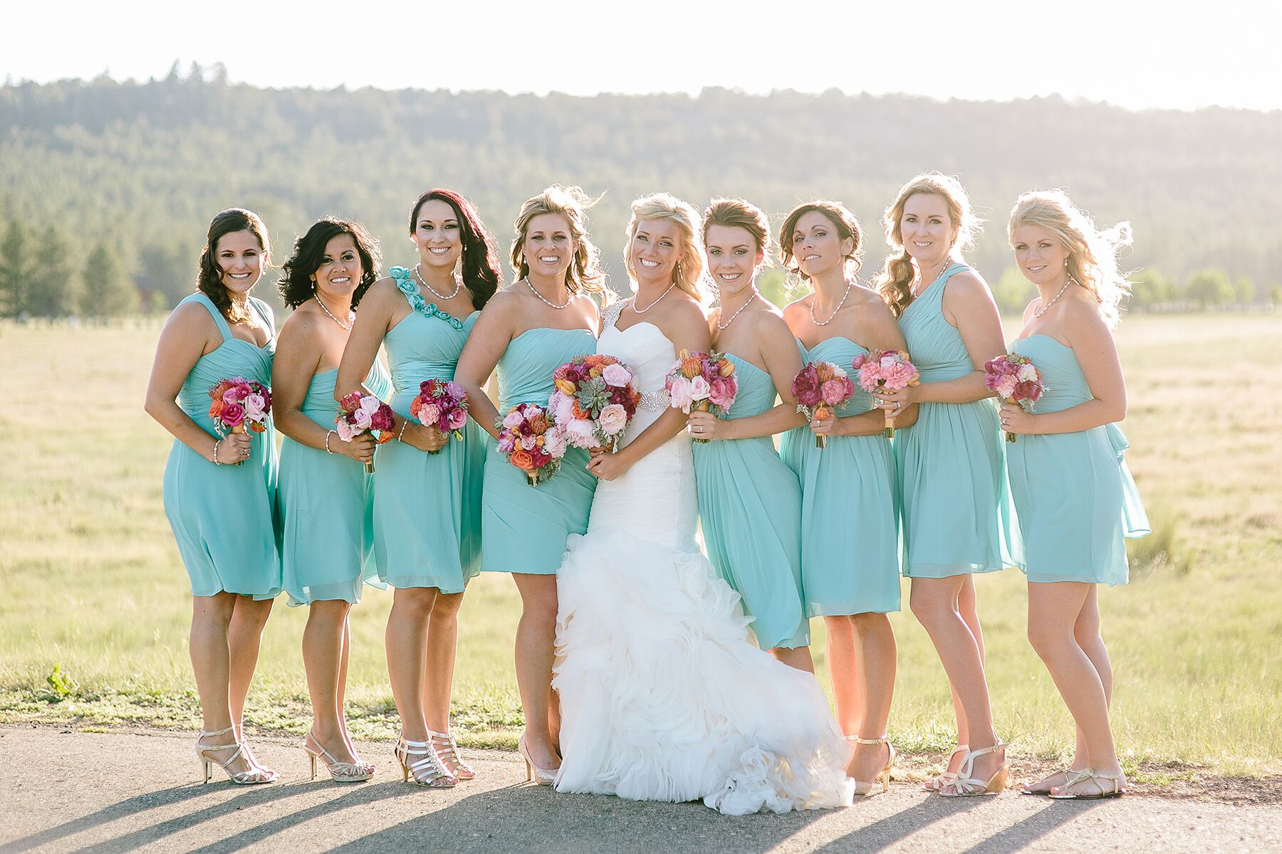 A whimsical pink and turquoise dessert table short mismatched turquoise bridesmaid dresses with red and pink bouquets ombrellifo Choice Image