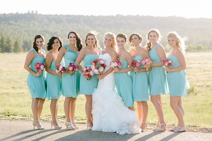 Short Mismatched Turquoise Bridesmaid Dresses With Red And Pink Bouquets
