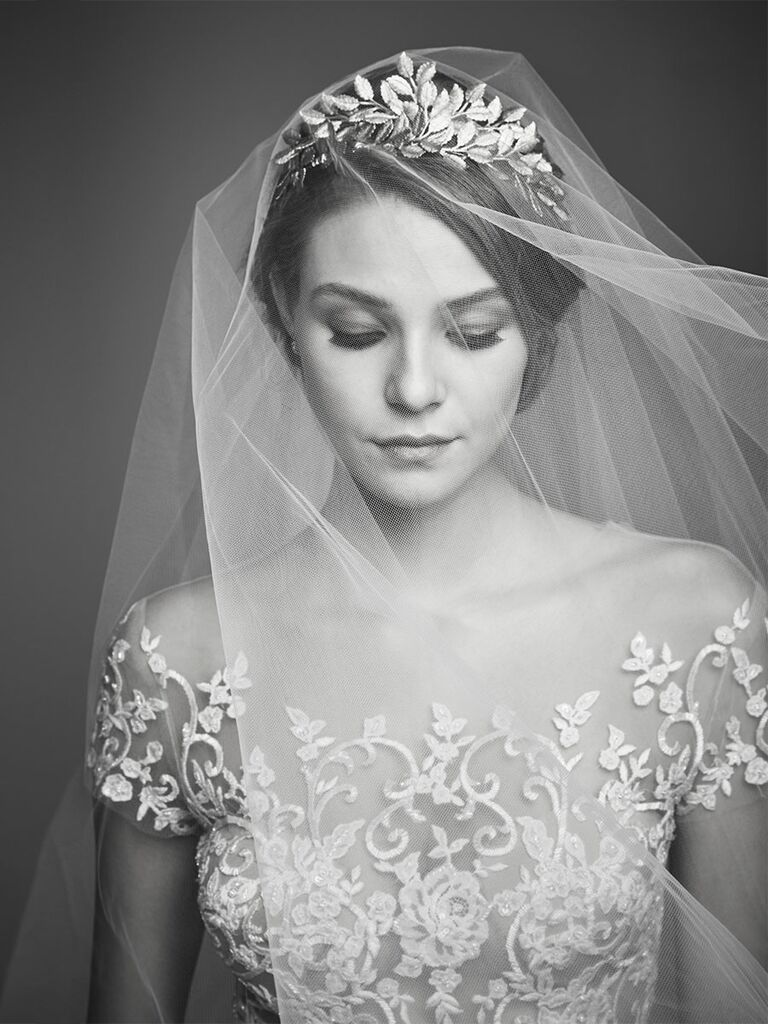 Ariel Taub wedding veil with a Hayden Harlow golden leaf head piece