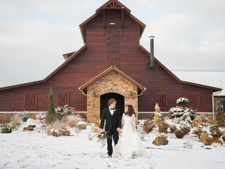 newly weds standing outside in the snow