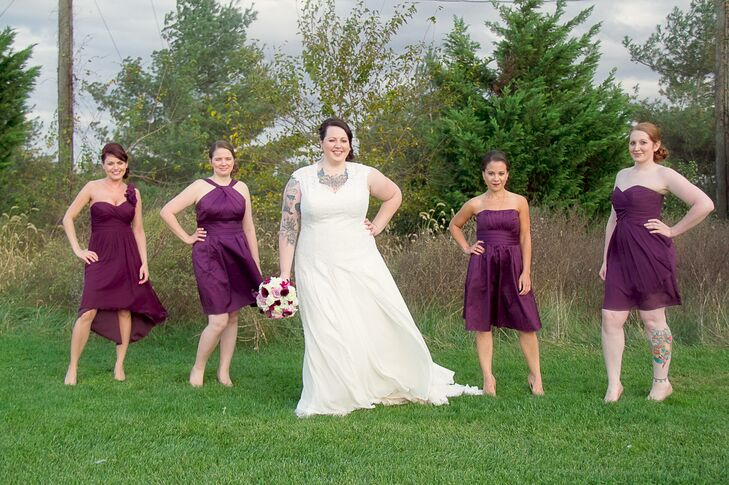 The bridesmaids wore different short plum dresses to complement their individual styles and personalities. Sophia gifted each of them a simple necklace and a floral getting-ready robe, both of which were purchased from Etsy.
