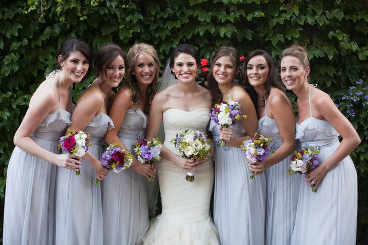 Audrey admits that she was always made fun of for her neutral color choices. However, she made sure her wedding was a true reflection of her and made gray the prominent color throughout the day. The bridesmaids wore floor-length gray dresses.