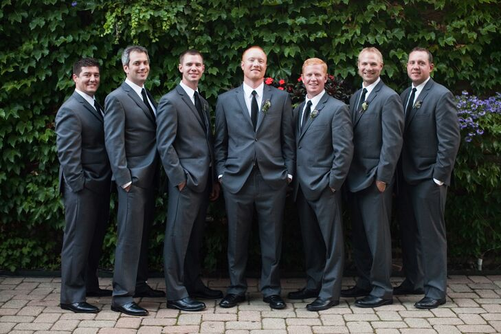 "Keeping with the gray look of the outdoor wedding, groomsmen wore charcoal gray suits. ""Black tuxedos seemed too formal for an outside wedding,"" Audrey says."