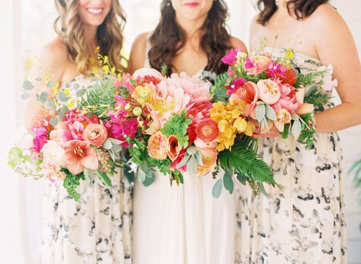 "Their bridesmaids' and bridal bouquets were filled with color. The team at Ever After Floral Design made every one with bold coral ranunculus, pink peonies, peach stargazer lilies, bougainvillea, yellow leaves, eucalyptus, greenery, orange tulips and blush ranunculus wrapped in silk ribbon. They even showcased Francesca's favorite fruit with a mini pineapple in her bouquet. ""I was overwhelmed by the beauty of the flowers the minute Helen [our florist] brought them to me,"" Francesca says. ""I was truly speechless."""