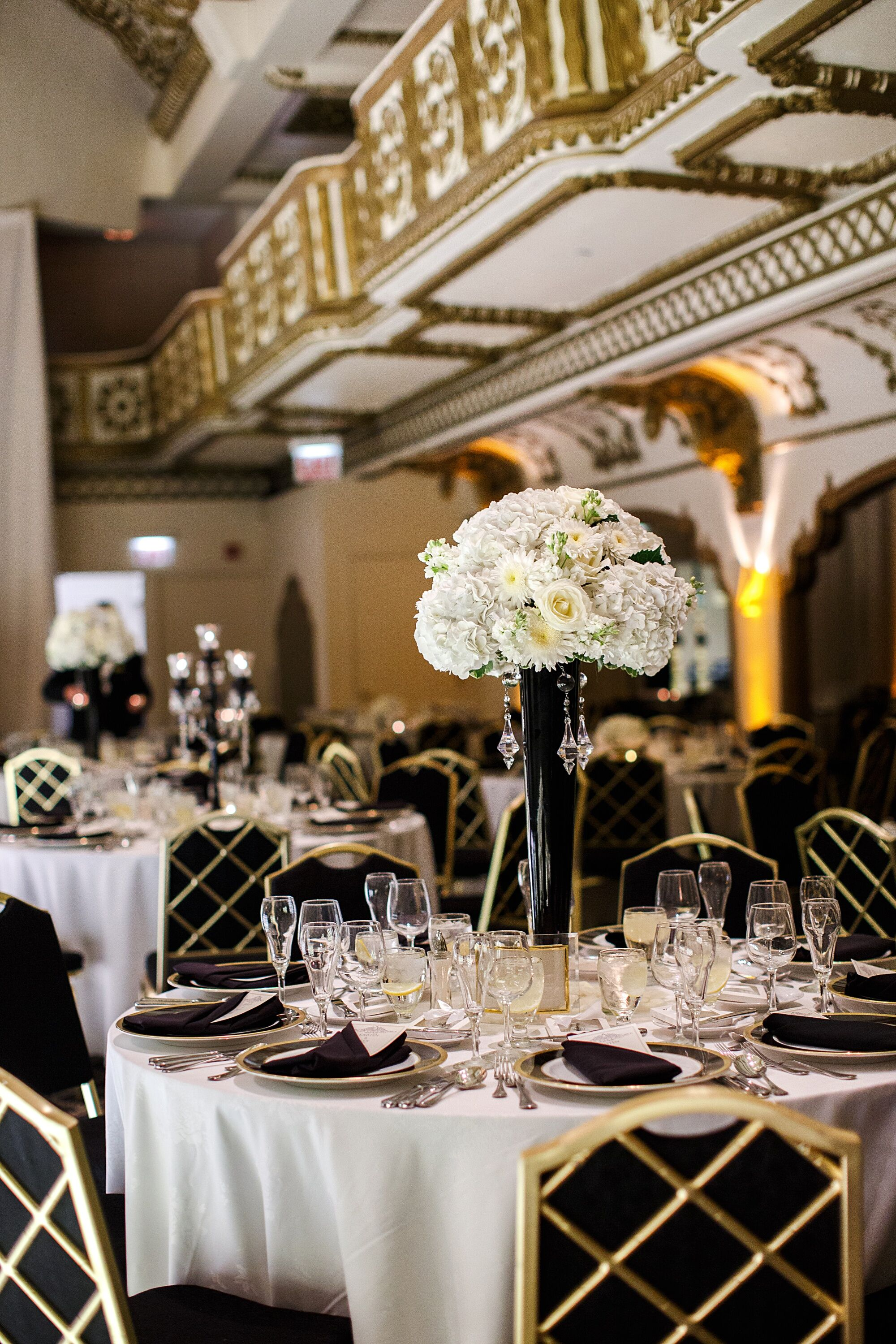 Black and gold art deco inspired wedding reception for Art deco wedding decoration ideas