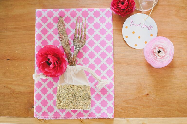 Small gold glitter favor bag with silverware
