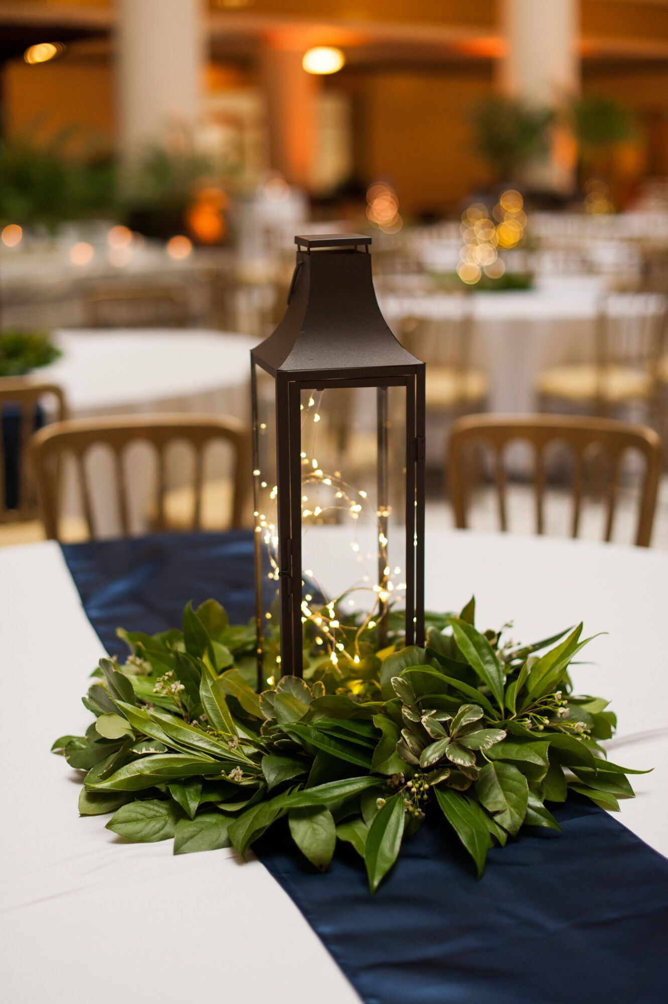 decorative lanterns for wedding centerpieces lantern centerpiece with simple greenery 3456
