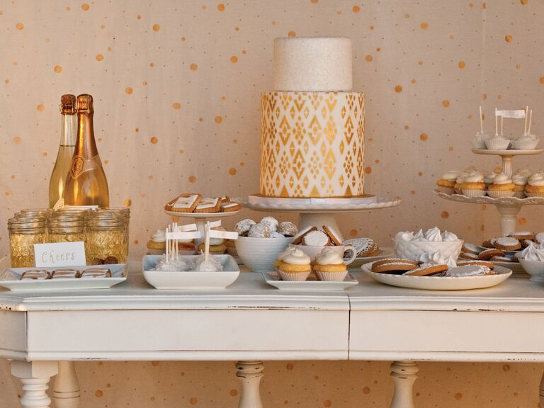 Gold wedding dessert table