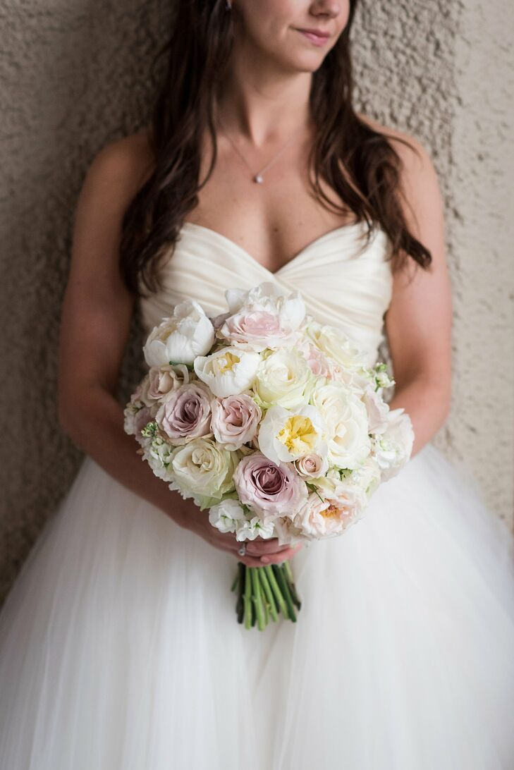 Kathleen carried peonies, roses and sweet peas in shades of ivory, blush and lavender. She wanted her look to be soft and romantic, and Les Bouquets nailed it. The steams were wrapped in a piece of Kathleen's mother's wedding dress.