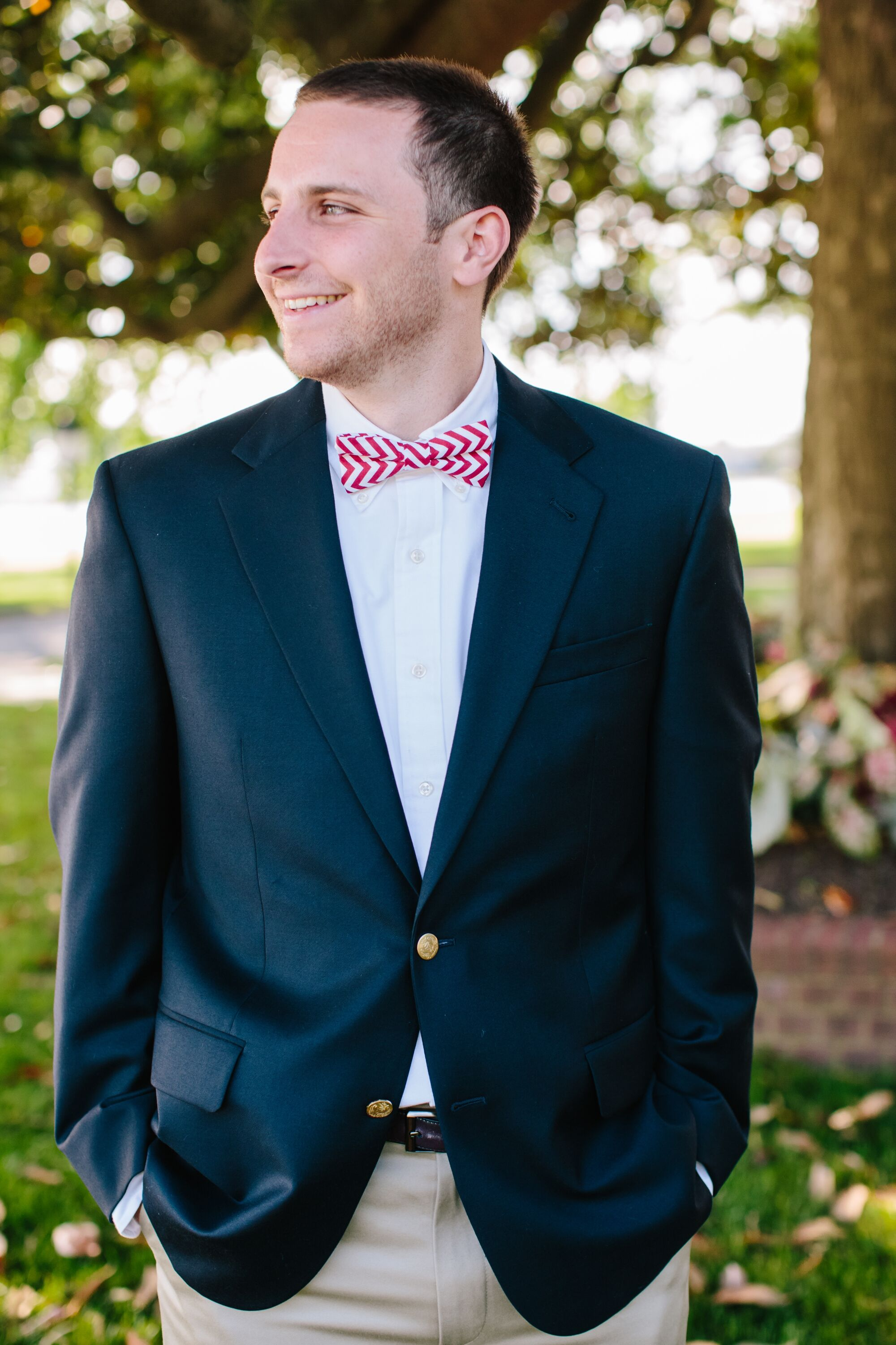 Groom In A Navy Blazer And Red Bow Tie
