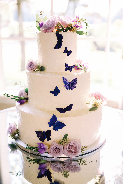 purple butterflies on the wedding cake