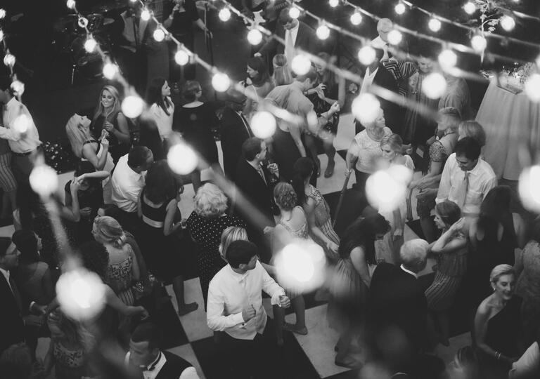 Reception dance floor under string lights