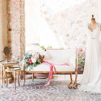 Jenny Packham wedding gown on dress form still life