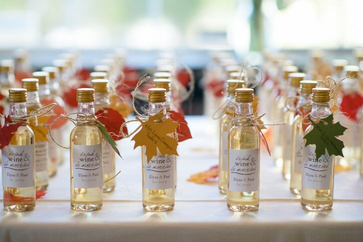 As favors, Elysa and Paul gave their guests miniature bottles of wine with customized labels, which tied in with the winery theme.
