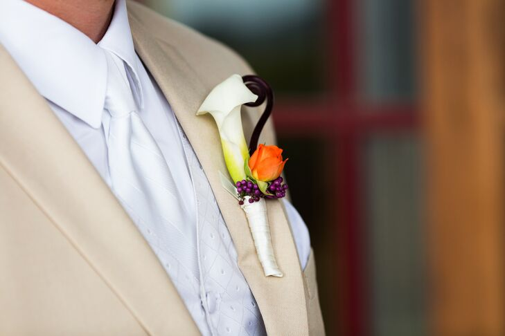 Rich had an ivory calla lily, orange rose and fiddlehead fern accented with purple stock as his boutonniere.