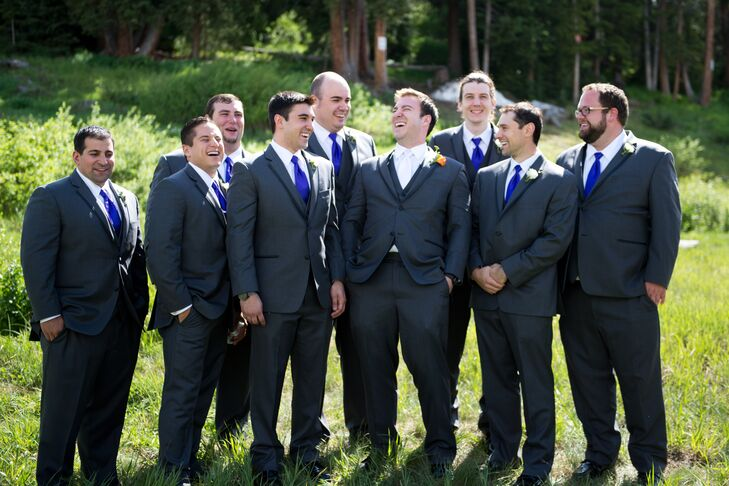 The groomsmen wore gray Vera Wang suits from Men's Wearhouse with purple ties to match the bridesmaid dresses. The groom wore a white tie to match the bride.