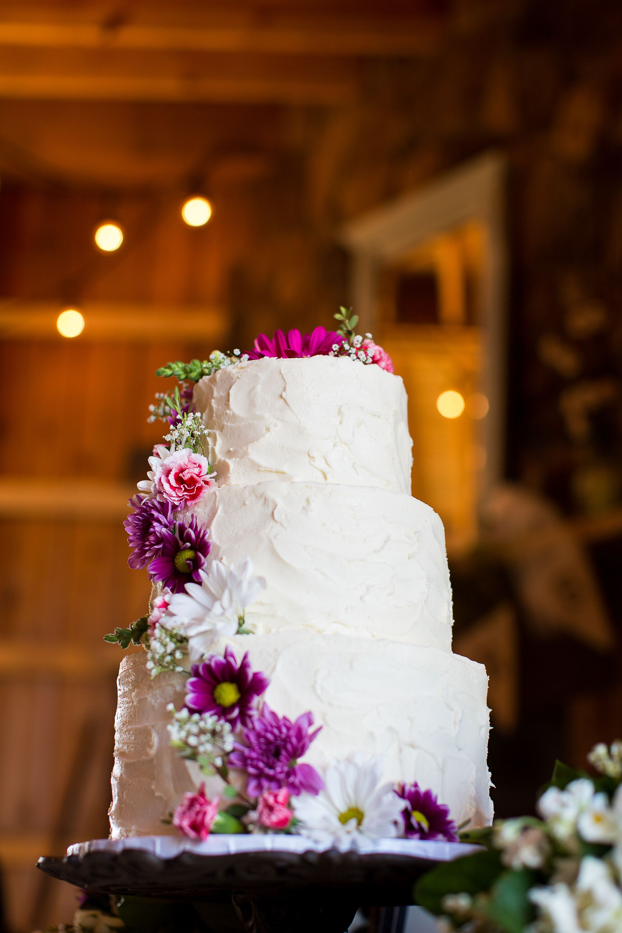 Buttercream Wedding Cake With Cascading Purple And White