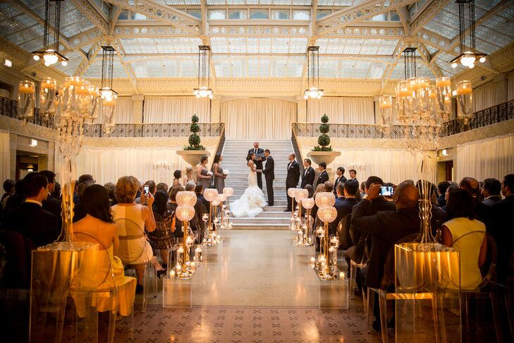 "Emily and Tyler immediately fell in love with the Rookery—a historic landmark in the heart of Chicago's financial district—from the moment they set foot inside the building. ""We held our wedding in the light court, which features white marble and wrought-iron staircases,"" Emily says. ""We wanted to incorporate as much of our venue into our design as possible."""
