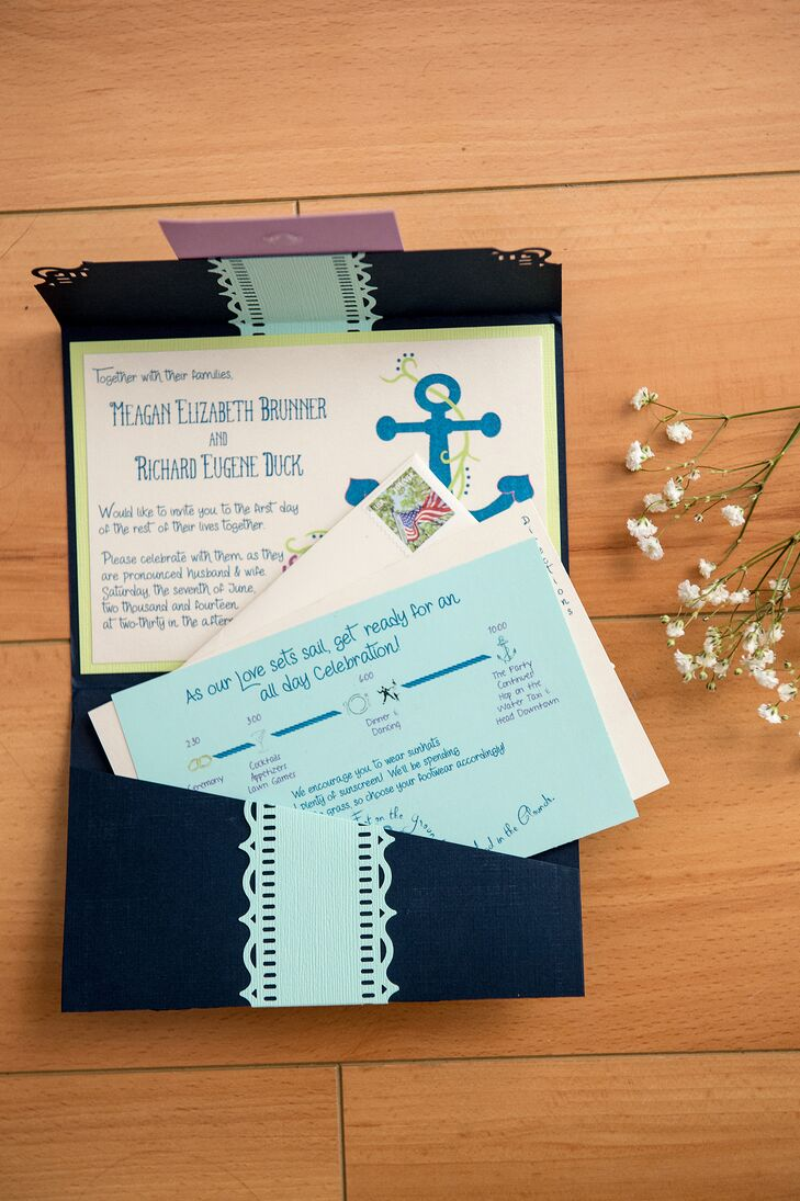 Meagan designed her own nautical-themed invites for her wedding. The paper goods featured anchor motifs and were made to resemble boarding passes, complete with navy fold-over envelopes and aqua accents.